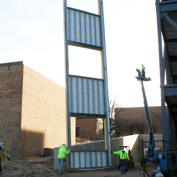panel being hoisted into place